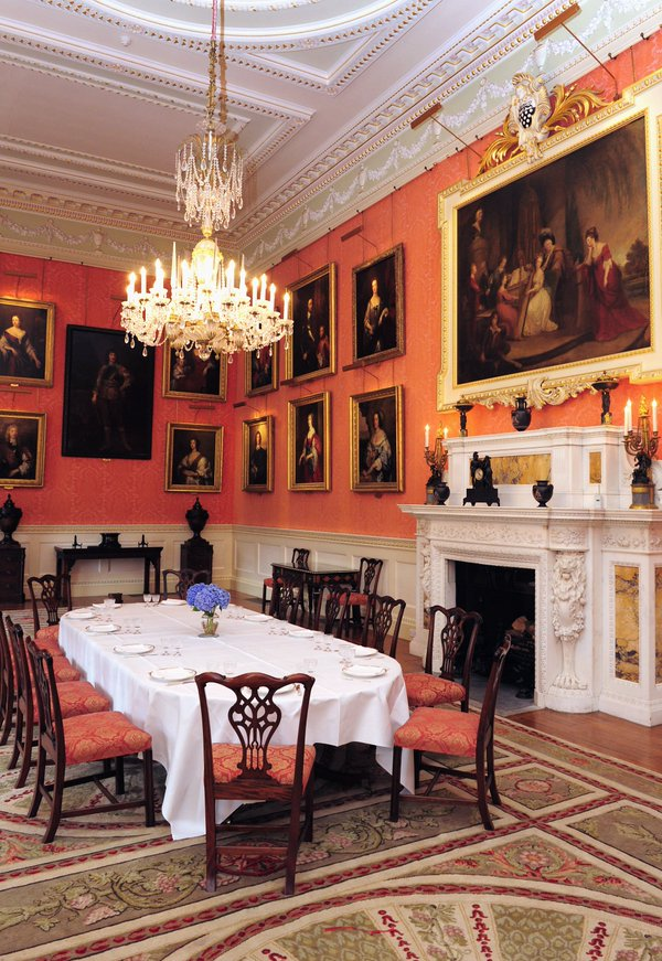 The dining room in more recent years, showing the extent of the family's twentieth-century alterations to both decoration and picture hang. Image: Weston Park.
