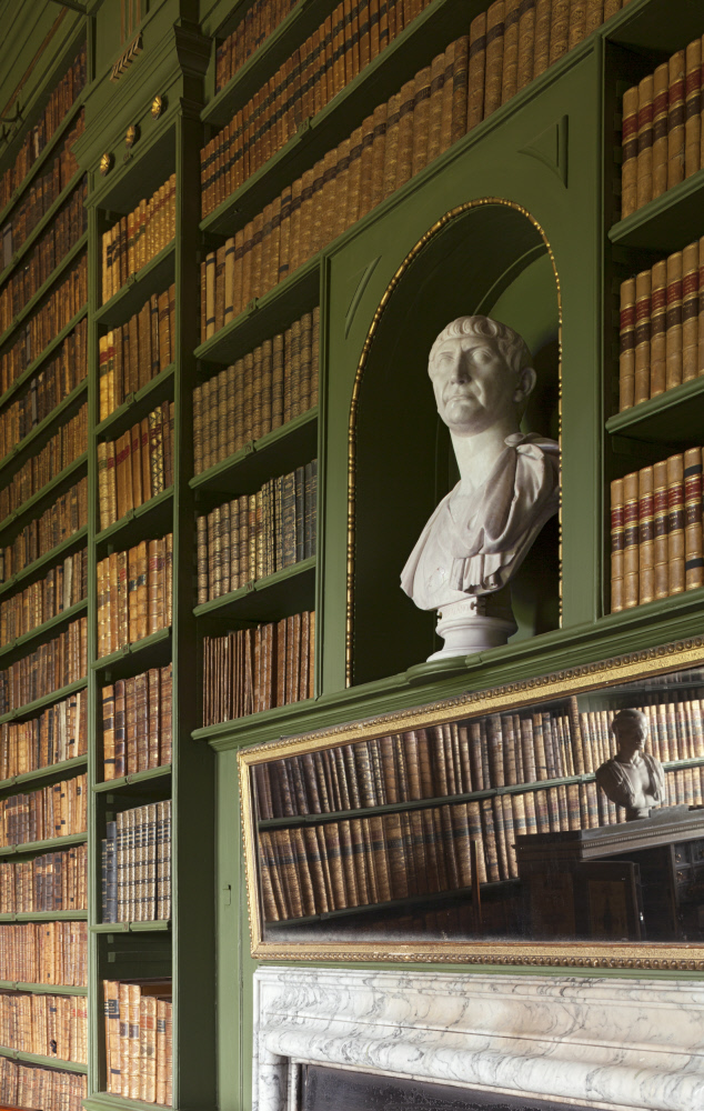 Bust of John Cust, 1st Earl Brownlow in an arched niche surrounded by bookshelves in the Study at Belton House. John Cust, 1st Earl Brownlow (1779-1853) by Joseph Nollekens (1737-1823), Carrerra marble. Belton House, Lincolnshire © National Trust Images/Dennis Gilbert
