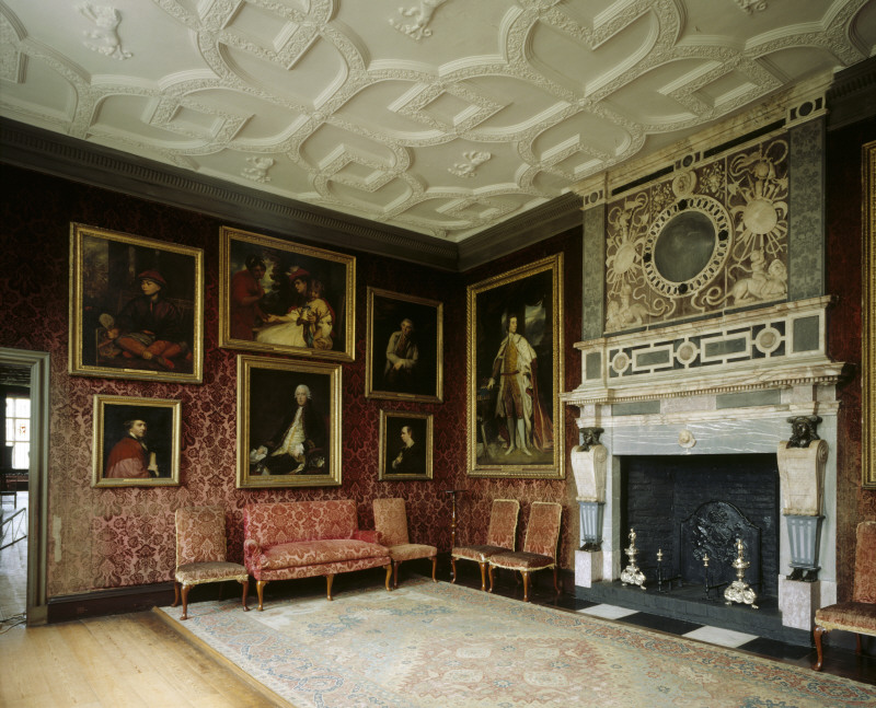 The interior of the Reynolds Room at Knole. It is also known as the Crimson Drawing Room due to the fact that its walls are hung with a rare early 18th Century crimson stamped woollen velvet. National Trust, Knole, Kent ©National Trust Images/Andreas von Einsiedel