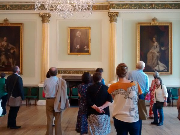 Attendees visit Bath's Guildhall with portraits of George III and Queen Charlotte by the studio of Reynolds