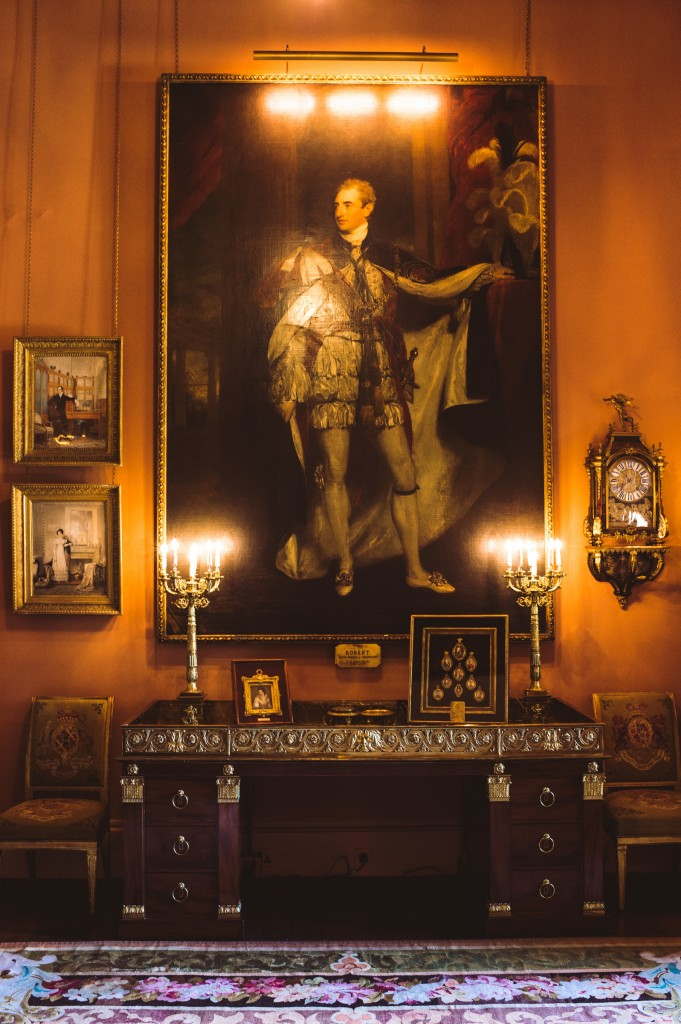 The Drawing Room at Mount Stewart. Robert Stewart, 2nd Marquess of Londonderry, KG (1769–1822) dressed in his robes as Knight of the Garter by Sir Thomas Lawrence, PRA (Bristol 1769 – London 1830), 1821, hanging above the grand desk given to Lord Castlereagh after the Congress of Vienna.