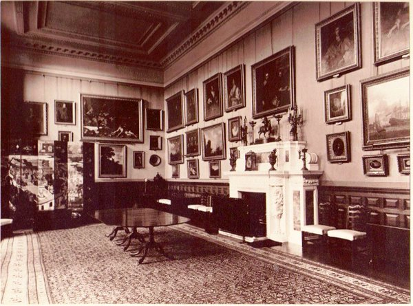 An archive image of the dining room at Weston Park c.1890 shows a busier, less ordered picture hang than is seen today. Image: Weston Park.