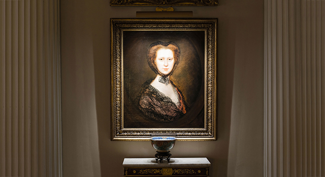 The even pool of light cast by the modern LED picture lights is flattering to the subjects of the portraits, in this case Viscountess Torrington, by Gainsborough. Image: T M Lighting Ltd www.tmlighting.com