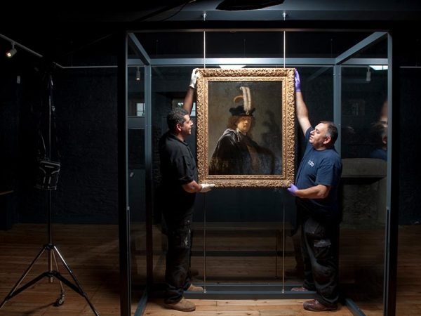 Rembrandt self-portrait, being installed for The National Trust's 2014 exhibition at Buckland Abbey. Image from: https://bit.ly/2uAc6Za