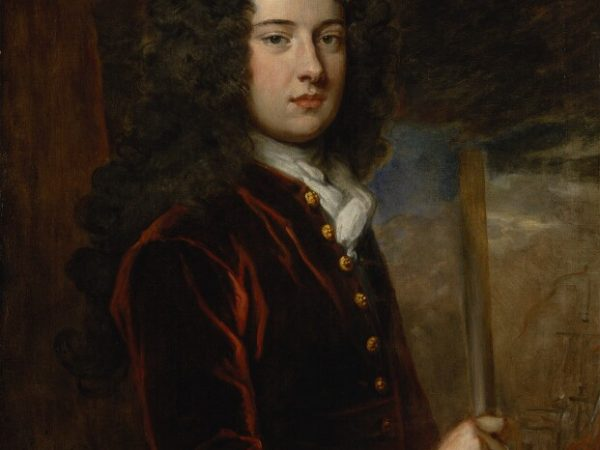 James Berkeley, 3rd Earl of Berkeley by Sir Godfrey Kneller, Bt., oil on canvas, c.1710 © National Portrait Gallery, London. Berkeley appears to be wearing a deep rust red silk velvet coat with a linen stock at his throat. The cuff of his linen shirt is just visible, emerging from the end of his coat sleeve.