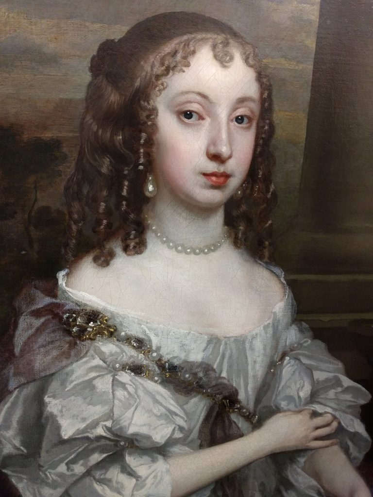 Detail of 'Sir Thomas Fanshawe, Kt., of Jenkins (1628-1705) and his 1st wife, Margaret (1635-1674)' showing the gold and diamond chain crossing Margaret's body and her pearl necklace and earrings. Valence House Museum, LDVAL 10