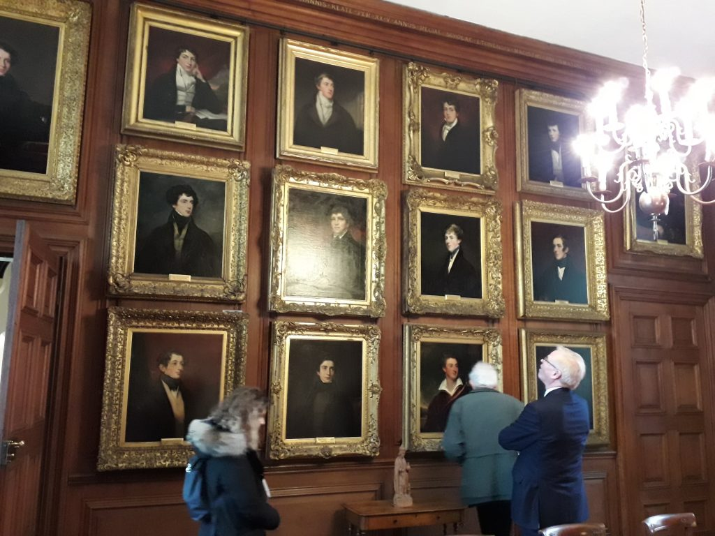 Delegates examining some of the Eton Leavers' Portraits
