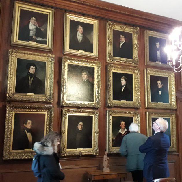 Delegates examining some of the Eton Leavers' Portraits