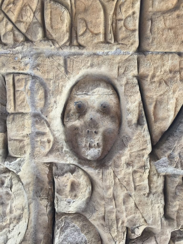 Memento mori skull 'graffiti' in the cloister, Eton College. Photography by the author