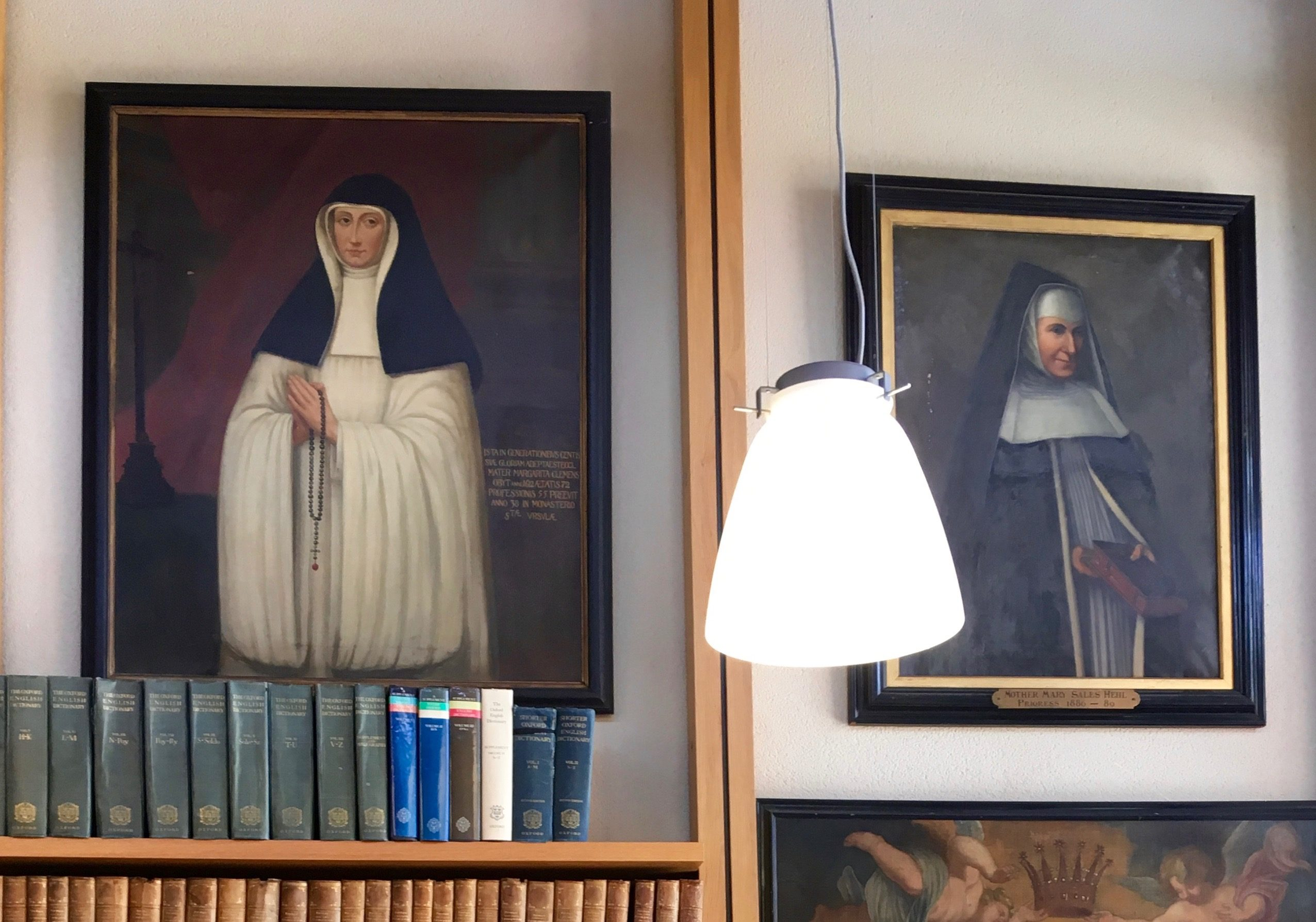 Portraits in the reading room of Mother Margaret Clement (1540–1612), and Mother Mary Sales Hehl, both English Canonesses of St Augustine. Image taken by the author